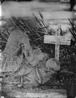 Civil War ghost visiting grave.