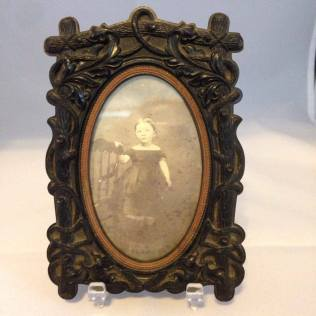 this frame holds a CDV sized image and is has a patent date of 1855